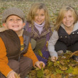 Three Young Children Playing Outdoors — Stock Photo