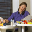 Young Mother Working From Home — Stockfoto