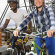 Stock Photo: Cyclists On A Bridge