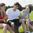 Athletes Relaxing On A Bench — Stock Photo #31938215