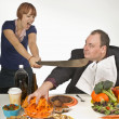 Woman Holding A Machete To Try To Stop Man From Overeating — Stock Photo