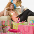 Two Women Surrounded By Gift Bags — Stockfoto