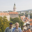 Couple Sitting With Krumlov Chateau And Round Tower In Background — Stock Photo