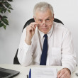 Stock Photo: Businessman Working At Desk