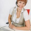 Woman Wearing Headset While Sitting At Desk — Foto Stock