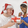 Overweight Man Giving Christmas Present To Slim Woman — Stock Photo