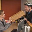 Bicycle Courier Giving Box To Office Receptionist — Stock Photo