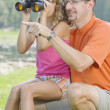 Father And Daughter By A Lake With Binoculars — Stock Photo