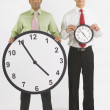Businessmen Holding Clocks — Stock Photo