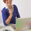 Happy Businesswoman Sitting At Her Desk — Stock Photo