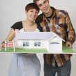 Couple Holding Model Home — Stock Photo