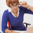 Upset Businesswoman Working At Her Desk — 图库照片