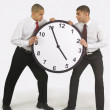 Businessmen Fighting Over A Clock — Stock Photo
