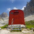 Red Supply Shed On A Mountain Trail. Campanile, Friuli Venezia Giulia, Italy — Stock Photo