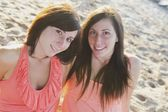 Two Young Women Sitting On The Beach — Foto Stock