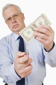 Businessman About To Burn Money — Stock Photo