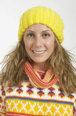 Pretty Woman Wearing A Sweater And Yellow Hat — Stockfoto