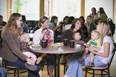 Group Of Young Mothers Relaxing In Cafe — Stock Photo
