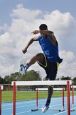 Man is running on the speed steeplechase — Stock Photo