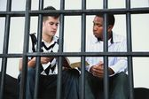 Young Man Reads The Bible To Another Young Man In Jail — Stock Photo
