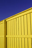 Bright Yellow Fence With Blue Sky And Snow — Stock Photo