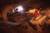 Cave And Woman Caver — Stock Photo