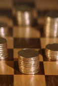 Piles Of Pennies On Checkerboard — Stock Photo