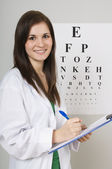 Optometrist Writing On Chart — Stock Photo