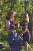 Mother And Daughter With Flowers In Park — Stock Photo