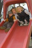 Three Young Children Playing At A Playground — Stok fotoğraf