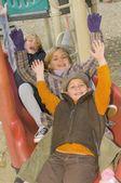 Three Children Playing At A Playground — Stock Photo