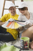 Couple Looking At Paint Swatches — Stock Photo