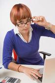 Upset Businesswoman Working At Her Desk — Stock Photo