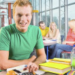Male College Student Working On Assignment — Stock Photo