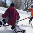 Boys Playing Ice Hockey On An Outdoor Rink — 图库照片