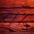 Three Nails In Wood In Red Tones — Stock Photo