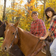 Stock Photo: Couple Going Horseback Riding