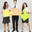 Three People Holding Oversized Puzzle Pieces — Stock Photo
