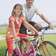 Father And Daughter With Bicycles At A Park — Stock Photo