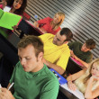 College Students In Classroom — Stock Photo #31940757