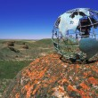Globe Overlooking Valley — Stock Photo