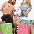 Women Looking At Their New Purchases — Stock Photo