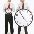 Businessmen Holding Clocks — Stockfoto #31941303