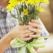 Boy Holding A Bouquet Of Yellow Daisies — Stock Photo