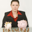 Stock Photo: BusinesswomWith Two Piggy Banks