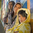 Three Teenagers Leaning Against A Graffiti Covered Wall — Стоковая фотография