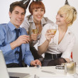 Three Business People Drinking Wine At Work — Stock Photo