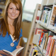 Young Woman In A Library — Stockfoto