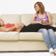 Pregnant Woman Relaxing On Couch With Her Friend — Stock Photo