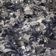 Stock Photo: Pile Of Discarded Asphalt Roofing Shingles In Recycling Yard